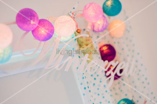 Ball fairy lights and decorative lettering