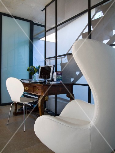 White Bauhaus armchair and antique desk in contemporary house