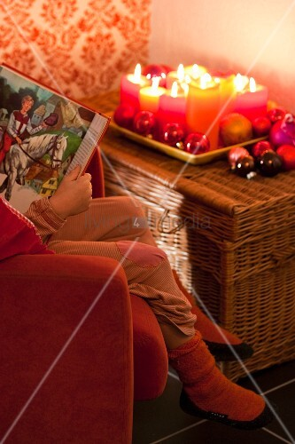 A child reading a book of fairy tales (Christmas)