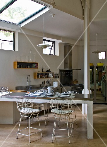 Open-plan living and dining room in loft apartment