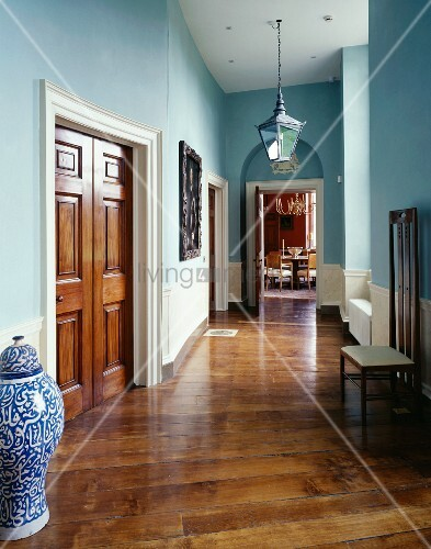 Traditional Hallway Painted Light Blue With Chinese Floor Vase Next