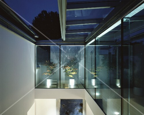 Double Height Room With Sliding Glass Roof And View Of Night Sky