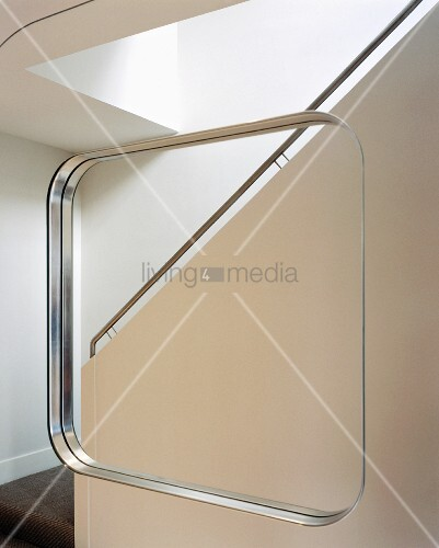 Mirror image of a purist staircase with stainless steel handrail
