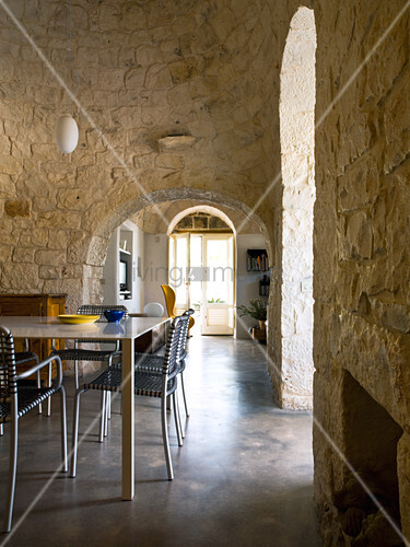 Dining room with stone vaulted ceiling in a Trullo house