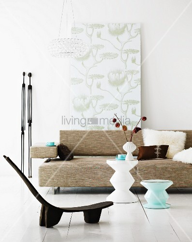 Low, ethnic-style chair in front of side table and sofa