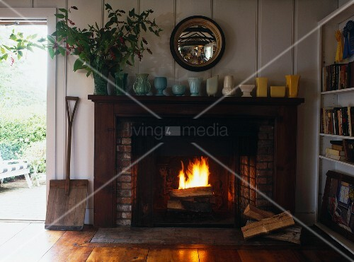 Roaring fire in open fireplace