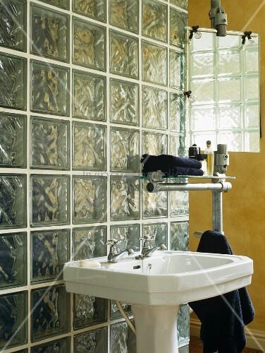 Retro pedestal washstand against glass brick wall