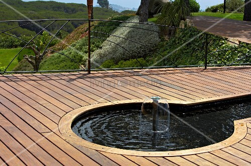 Wooden terrace with water feature