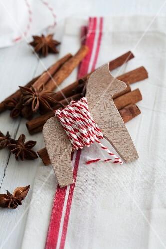 Wooden animal as yarn reel, cinnamon sticks and star anise