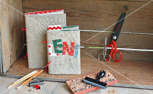 Hand-made linen book covers with name in fabric lettering