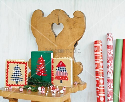 Hand-made Christmas cards with Christmas tree motifs on farmhouse chair