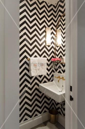 Black and white zigzag wallpaper in small bathroom