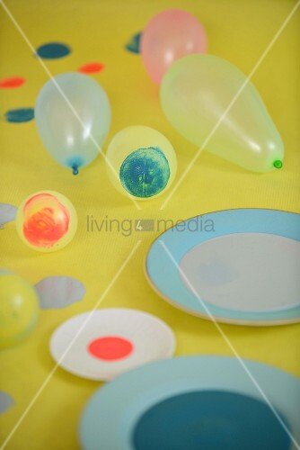 Dishes of paint and balloons with circles of paint