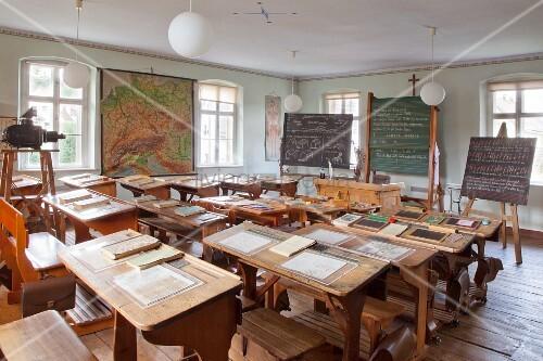Slates on old school desks in vintage schoolroom in village school museum