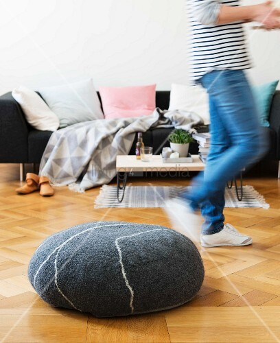 A homemade crocheted floor cushion made from felting wool