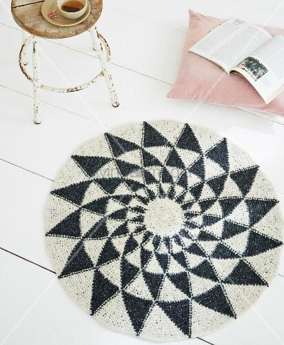 A homemade crocheted rug made from felting wool