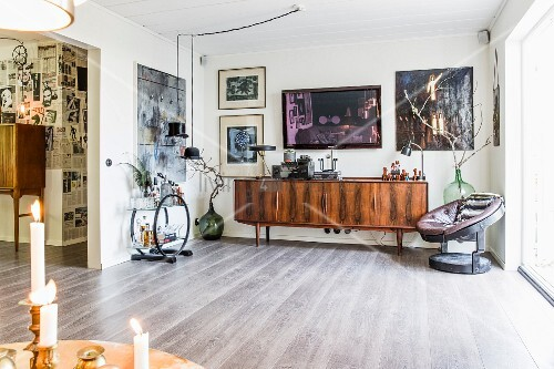 Arc Deco sideboard, retro wooden sideboard and armchair in open-plan living area