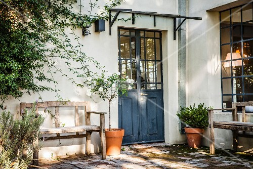 Mediterranean Lattice Front Door And Weathered Bench