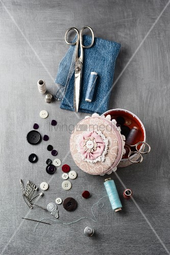 Sewing supplies on grey surface
