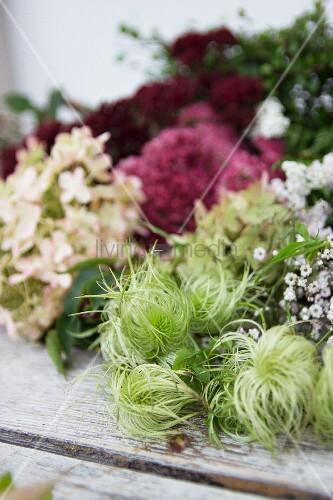Autumnal flower arrangement on weathered wooden surface