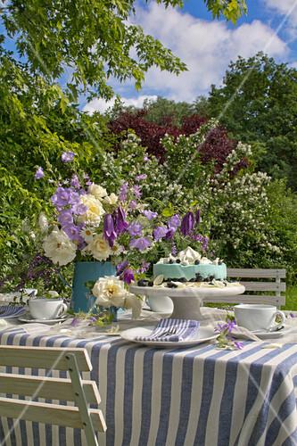 Garden table festively set in blue and white