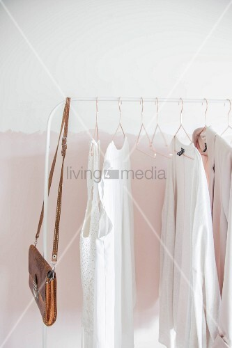 Women's clothing on white clothes rail