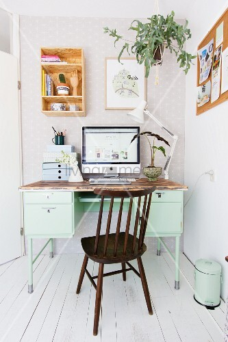 Shelf and hanging basket above old desk and Windsor chair