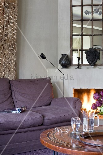 Open fire in comfortable reading corner