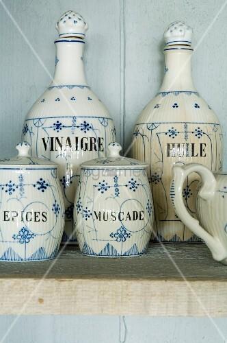 Vintage crockery on wooden shelf