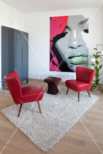 Living room simply furnished with retro furniture and pop-art picture