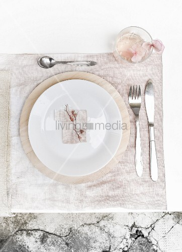 Place setting on pale pink place mat dyed using hydrangea flowers
