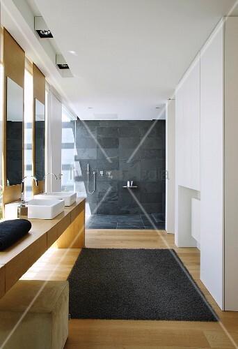 Modern bathroom with open, floor-level shower