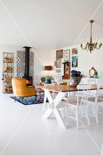 Living-dining area in open-plan interior with white floor