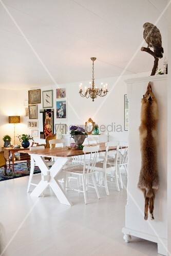 Comfortable interior with living and dining areas and white floor