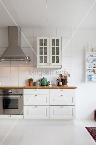 White country-house kitchen with white floor and wall-mounted cabinet