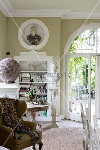 Stucco elements and ornate arched French window in grand interior