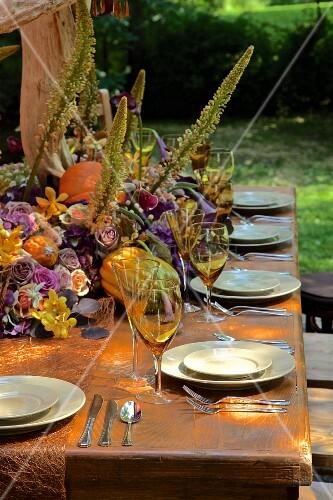 Autumnally set dining table outside barn (USA, East Coast, New England)