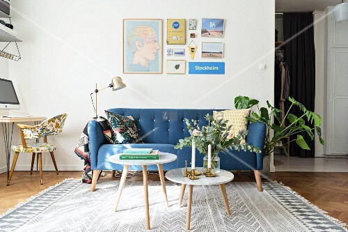 Blue retro sofa, standard lamp and side table in living room