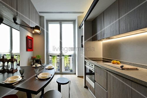Elegant kitchen with indirect lighting in apartment