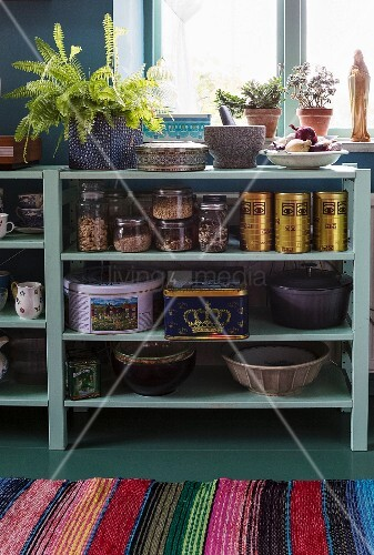 Vintage-style cans and jars on open-fronted kitchen shelves