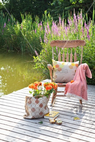Dahlias in bag next to rocking chair on wooden deck