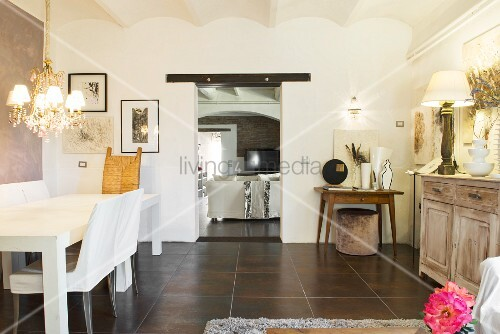 Modern dining table in converted wine cellar with vaulted ceiling