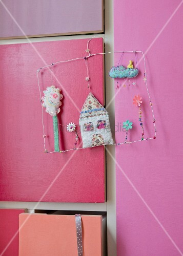 Artwork made from coathanger and textiles hung on cupboard door