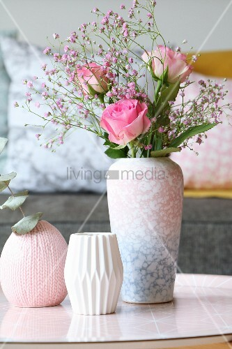 Roses and pink gypsophila in mottled vase