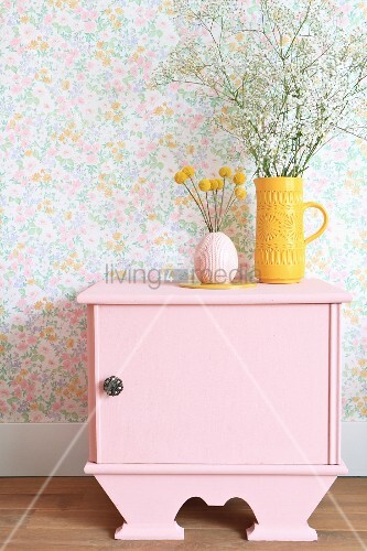 Vases on top of old bedside cabinet painted pink