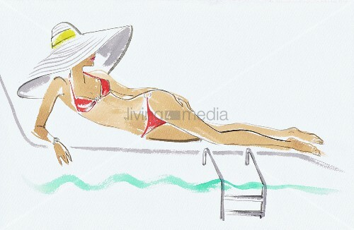 Woman wearing large sun hat reclining on sun lounger beside swimming pool