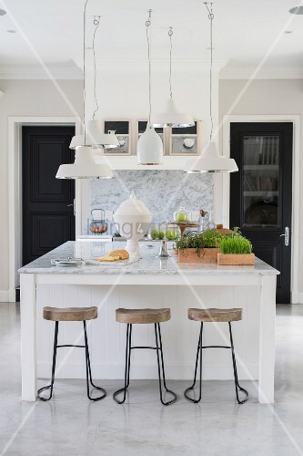 Group of ceiling lamps above island counter with marble top