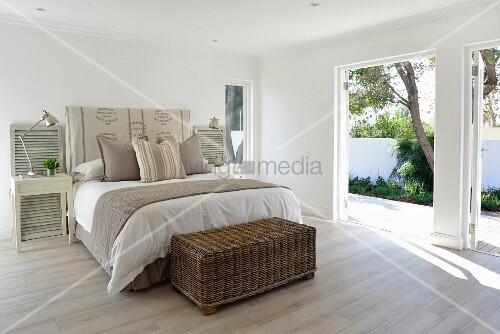Bedroom in sandy shades with open terrace doors