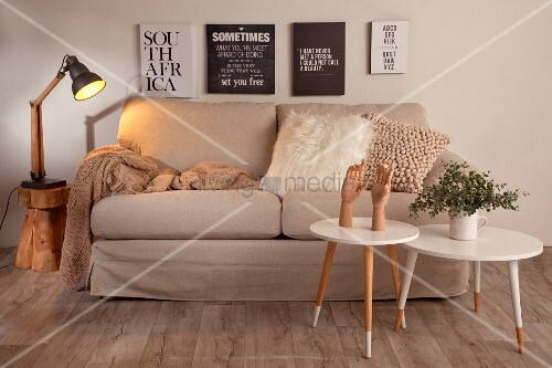 Beige and white living room with typography prints above sofa