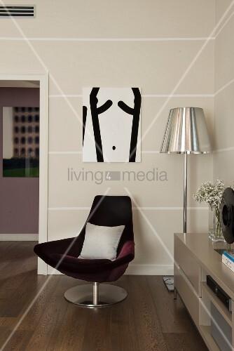 Claret-red velvet easy chair against striped wall
